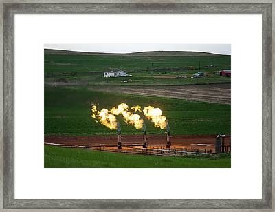 Gas Flares At An Oil Field Framed Print by Jim West