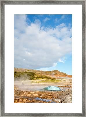 Geyser Erupting Framed Print by Ashley Cooper