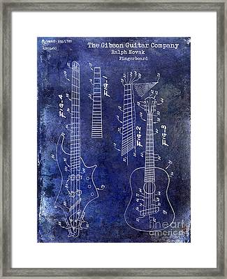 Gibson Guitar Patent Drawing Blue Framed Print by Jon Neidert