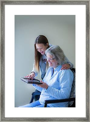 Girl Showing Grandmother Tablet Framed Print
