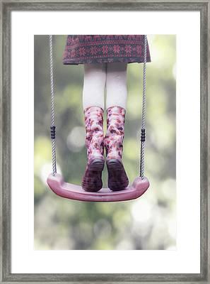 Girl Swinging Framed Print