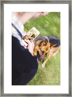 Girl Taking Photo Of Dog With Smart Mobile Phone Framed Print by Jorgo Photography - Wall Art Gallery
