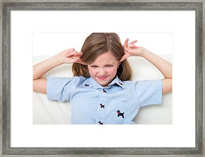 Girl With Her Fingers In Ears Framed Print by Lea Paterson