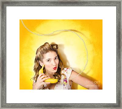 Gossiping Retro Pin Up Girl On Fruit Phone Framed Print by Jorgo Photography - Wall Art Gallery
