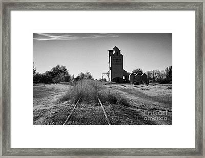 grain elevator and old train track landmark bengough Saskatchewan Canada Framed Print