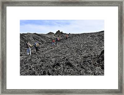 Group Of Hickers Walking On Cooled Lava Framed Print by Sami Sarkis