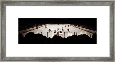 Group Of People Playing Ice Hockey Framed Print by Panoramic Images