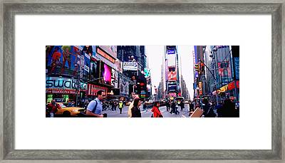 Group Of People Walking On The Road Framed Print by Panoramic Images