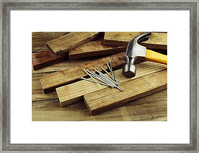 Hammer And Nails  Framed Print by Les Cunliffe