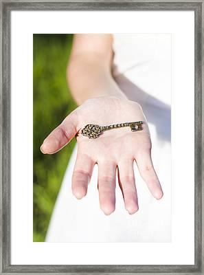 Hand Holding Key Framed Print