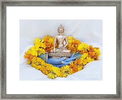 Hands Holding Buddha Framed Print