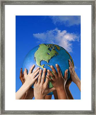 Hands On A Globe Framed Print by Don Hammond