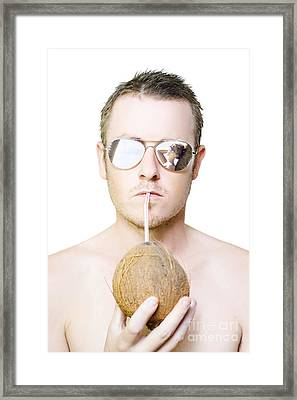 Handsome Summer Man Drinking Coconut Cocktail Framed Print by Jorgo Photography - Wall Art Gallery