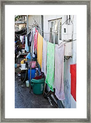 Hanging Towels Framed Print by Tom Gowanlock