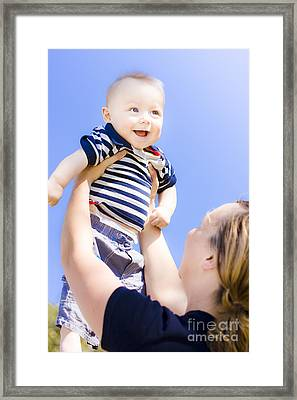 Happy Baby Held Up To The Sky Framed Print