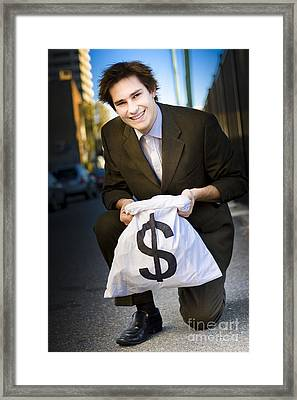 Happy Business Man Smiling With Money Bag Framed Print