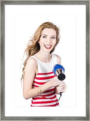 Happy Female Hairdresser Holding Hairdryer Framed Print