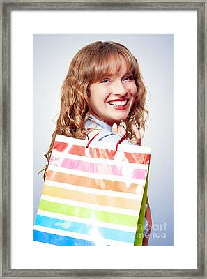 Happy Female Retail Shopper With Bag And Smile Framed Print