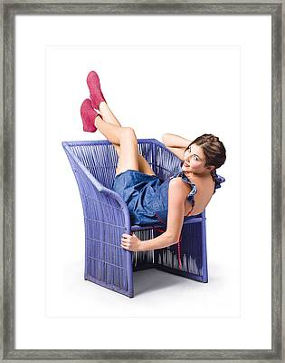 Happy Woman In Denim Dress Kicking Back On Chair Framed Print by Jorgo Photography - Wall Art Gallery