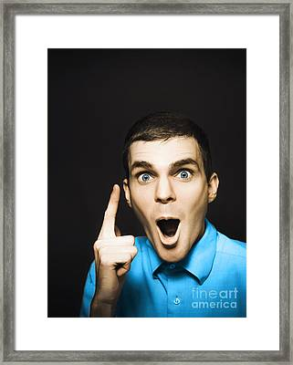 Happy Young Man Pointing At Blank Copyspace Framed Print by Jorgo Photography - Wall Art Gallery