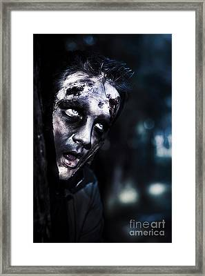 Head Of A Scary Zombie Peeking From Behind Tree Framed Print by Jorgo Photography - Wall Art Gallery