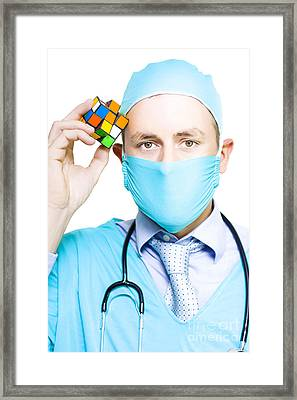 Healthcare Practitioner With A Medical Puzzle Framed Print