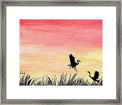 Herons At Sunset Framed Print by Prashant Shah