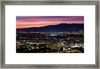 High Angle View Of A City At Dusk Framed Print