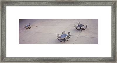 High Angle View Of Tables And Chairs Framed Print