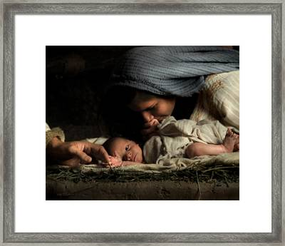 His Hands Framed Print