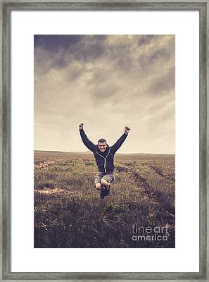 Holiday Man Jumping On Rural Australia Landscape Framed Print by Jorgo Photography - Wall Art Gallery