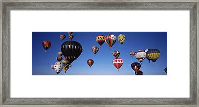 Hot Air Balloons Floating In Sky Framed Print by Panoramic Images