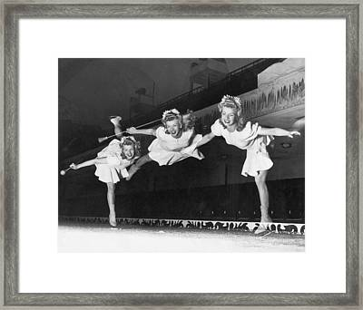 Ice Skater Triple Exposure Framed Print by Underwood Archives