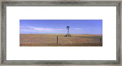 Industrial Windmill On A Landscape Framed Print
