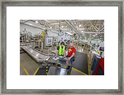 Intern Working At A Car Factory Framed Print by Jim West
