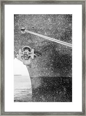 Interpid Under Snowfall Framed Print