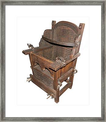 Iron Torture Chair Framed Print by David Parker