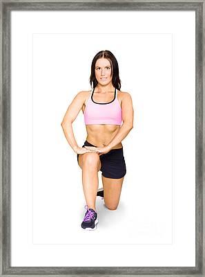 Isolated Female Athlete Stretching Before Exercise Framed Print