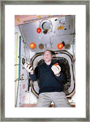 Iss Astronaut Juggling Framed Print by Nasa