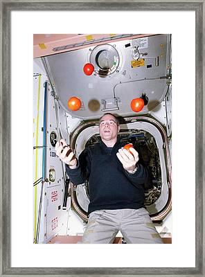 Iss Astronaut Juggling Framed Print