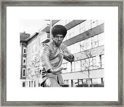 Jim Kelly Framed Print