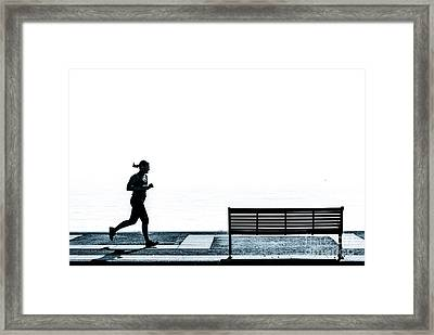 Jogging On The Prom. Framed Print by Peter Noyce