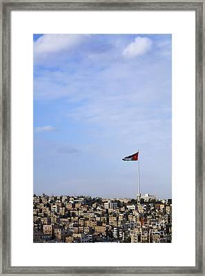 Jordanian Flag Flying Over The City Of Amman Jordan Framed Print