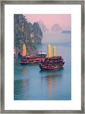 Junk Boat And Karst Islands In Halong Framed Print