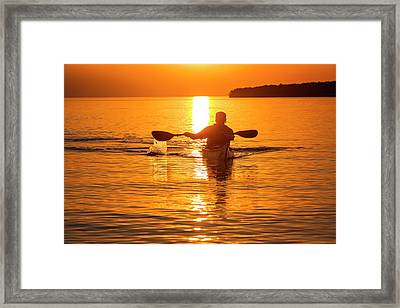Kayaking At Sunset In The Apostle Framed Print by Chuck Haney