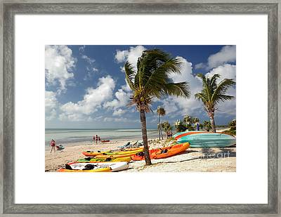 Kayaks On The Beach Framed Print by Amy Cicconi