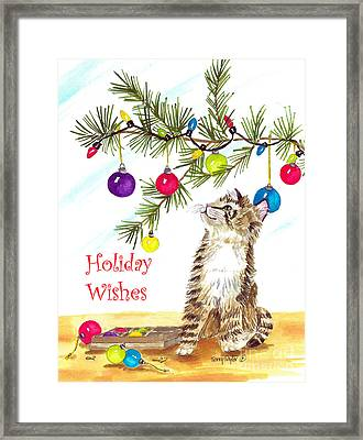 Kitten's First Christmas Framed Print