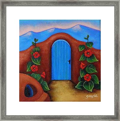 La Puerta Azul Framed Print