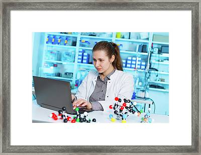 Lab Assistant Using A Laptop Framed Print