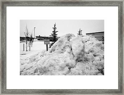 large pile of snow for collection cleared from residential streets Saskatoon Saskatchewan Canada Framed Print by Joe Fox